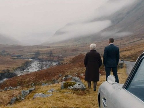 M and Bond look out over a fog covered Glencoe.